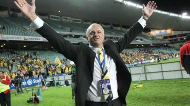 Graham Arnold after last year's A-League Grand Final triumph with the Mariners.
