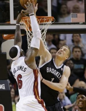 Brooklyn rookie Mason Plumlee stops LeBron James at the rim.