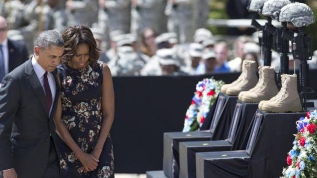 President Barack Obama and first lady Michelle Obama turn to leave after paying their respects during a memorial ...