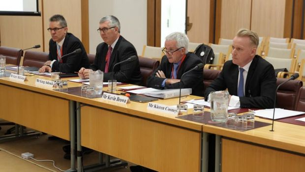 Gary McLaren, Greg Adcock, Kevin Brown and Kieren Cooney from NBN Co appear before a Senate hearing at Parliament House ...