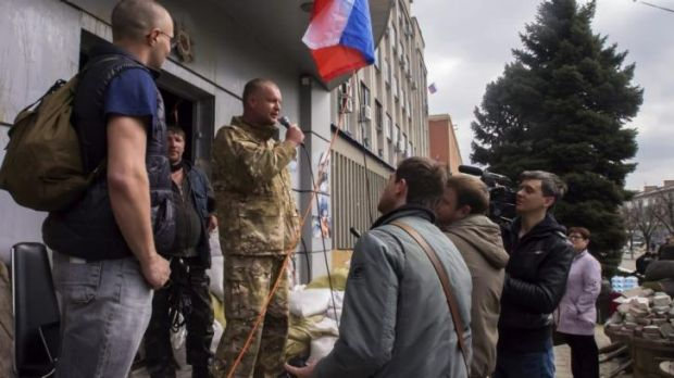 A pro-Russian activist, calling himself Vasiliy, speaks to other protesters in Luhansk.