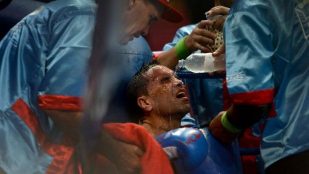 Anthony Mundine receives treatment from his corner during his match with Joshua Clottey.
