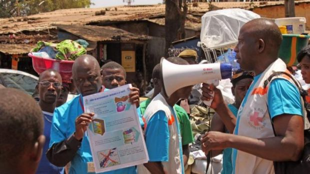 Health workers teach people about the Ebola virus and how to prevent infection in Conakry.