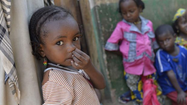 A young girl waits to receive medical aid northeast of Bangui.