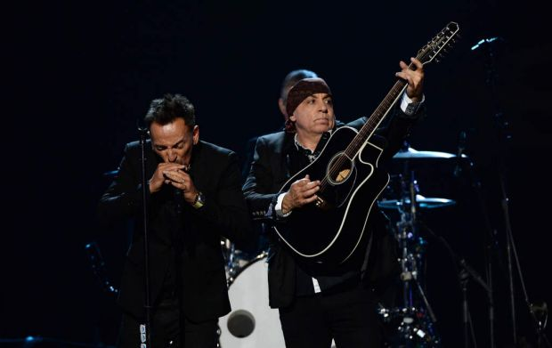 Bruce Springsteen and inductee Steven Van Zandt of the E Street Band perform onstage.