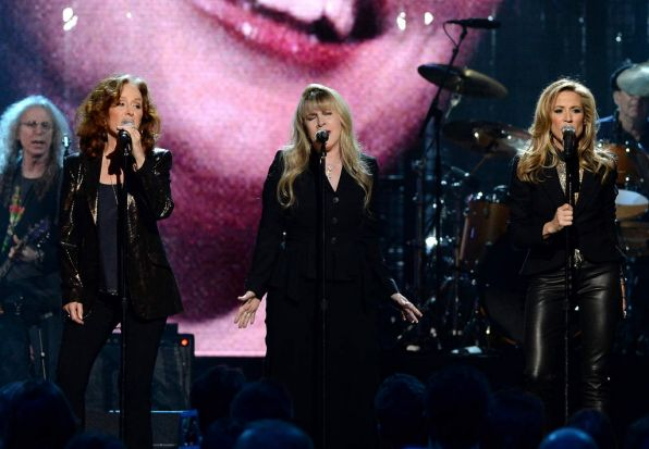 (Left to right) Bonnie Raitt, Stevie Nicks and Sheryl Crow perform onstage at the Hall Of Fame Induction Ceremony.