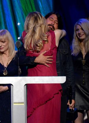 Nirvana inductee Dave Grohl hugs Courtney Love onstage at the 29th Annual Rock And Roll Hall Of Fame Ceremony.