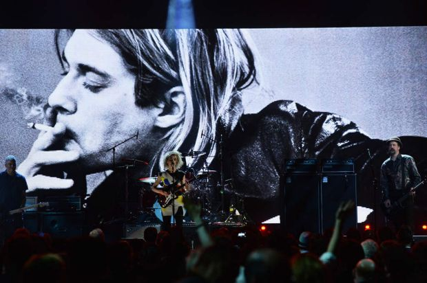 Cobain songs ... (L-R) Musicians Pat Smear, St. Vincent and Nirvana's Krist Novoselic at the 29th Annual Rock And Roll ...