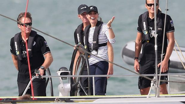 Catherine, Duchess of Cambridge gestures to Prince William, Duke of Cambridge, as she helms an America's Cup boat in a ...