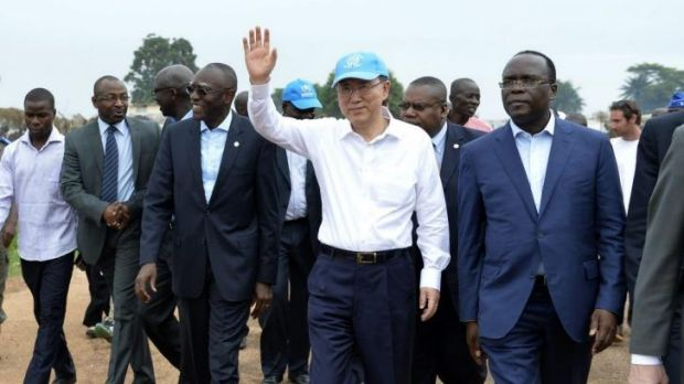 Keeping watch: UN Secretary-General Ban Ki-Moon waves as he visits the Bangui IDP camp.