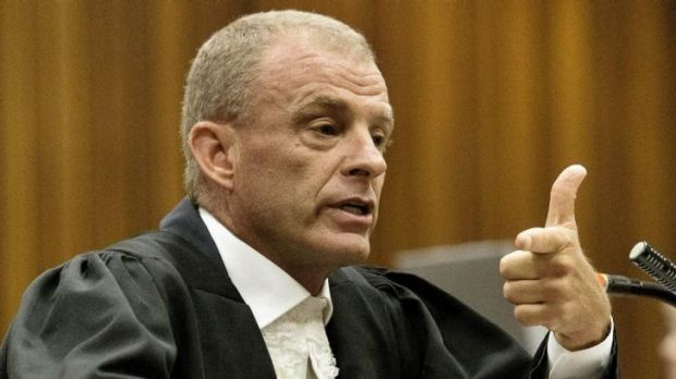 'You knew Reeva was behind the door and you shot at her': State prosecutor Gerrie Nel questions Oscar Pistorius.