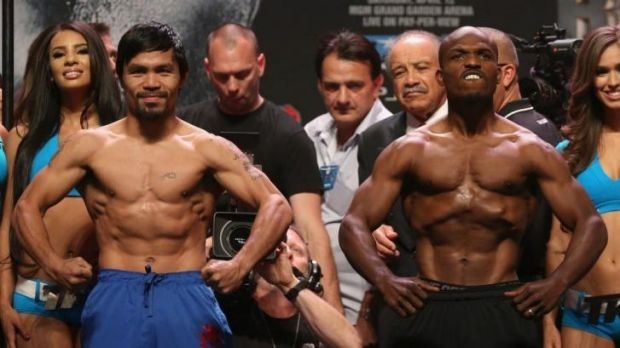 Manny Pacuiao and Timothy Bradley try not to be outdone by the other at the weigh-in.
