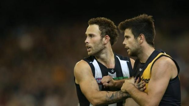 Brent Macaffer tussles with Trent Cotchin.