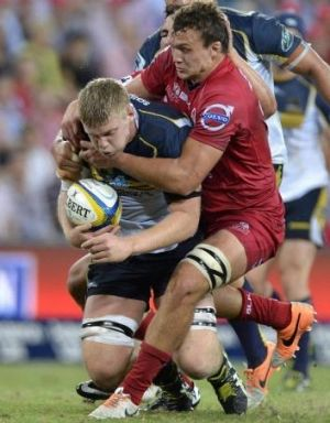 Tom Staniforth takes some stopping against the Reds.