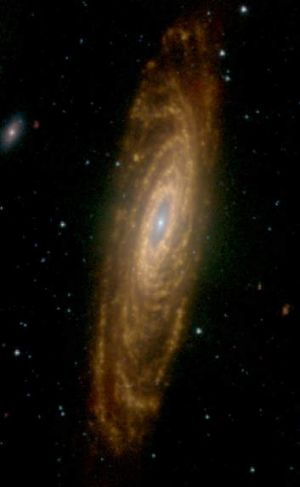 Galaxy NGC 7331 with a red glow coming from dust heated by hot stars.