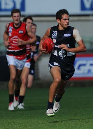 Jeff Garlett makes a break during the match against the Frankston Dolphins on Saturday.
