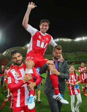Harry Kewell is chaired off the field after his final match on Saturday.