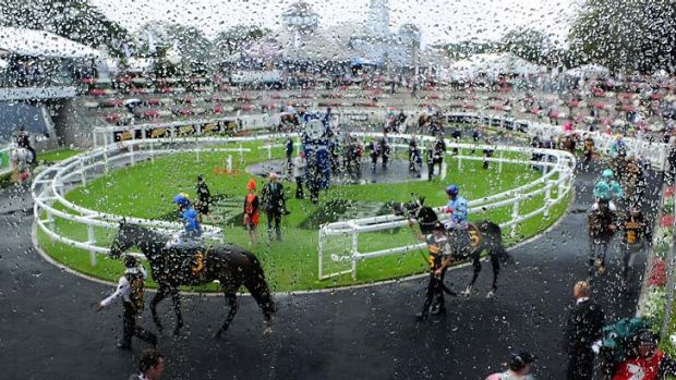 Rain on the parade: Under cover was the place to be as the weather worked against the first day of The Championships.