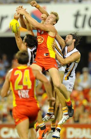 Tom Lynch and Luke Hodge fly for the ball.