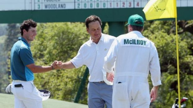 McIlroy of Northern Ireland shakes hands with marker Jeff Knox on the 18th green.