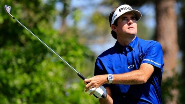 Bubba Watson dropped shots on the back nine but remains in a share of the lead.