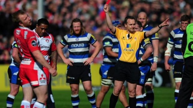 Sila Puafisi of Gloucester receives a red card from referee Tim Wigglesworth.
