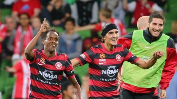 The Wanderers celebrate Youssouf Hersi's match-winning goal against Melbourne Heart.
