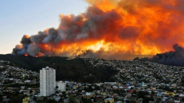Red alert: Houses burn in Valparaiso, 110 kilometres west of Santiago.