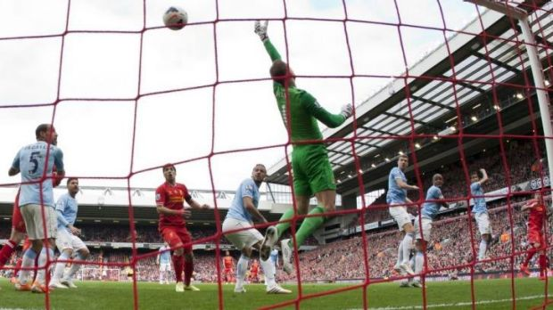 On the mark: Liverpool's Martin Skrtel, right, scores past Manchester City's goalkeeper Joe Hart.