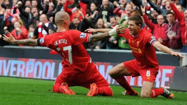 Jubilation: Liverpool captain Steven Gerrard celebrates teammate Martin Skrtel's goal against Manchester City.