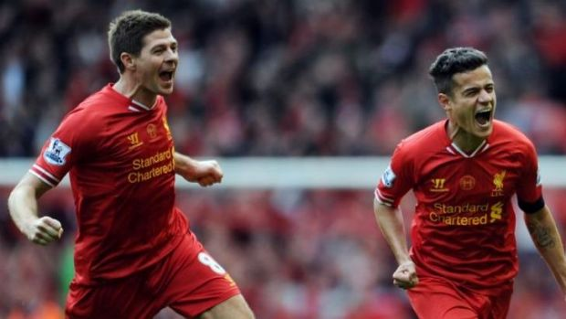 Liverpool's Steven Gerrard celebrates with Philippe Coutinho after the third goal against Manchester City.