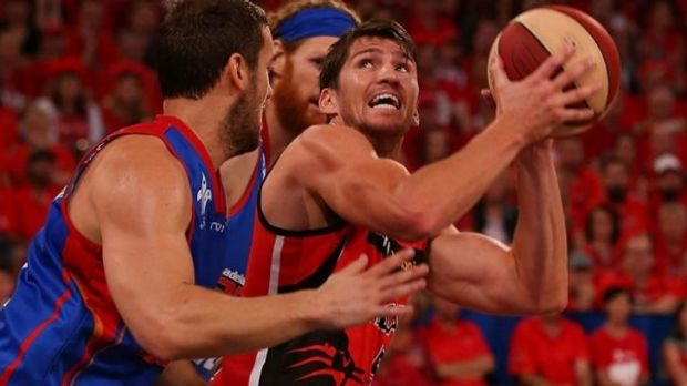 Wildcats' Damian Martin and 36er Adam Gibson go head-to-head at Perth Arena.