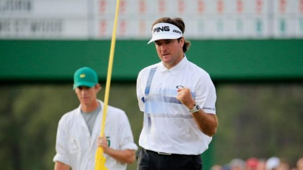 Bubba Watson celebrates on the 18th green after winning the 2014 Masters Tournament.