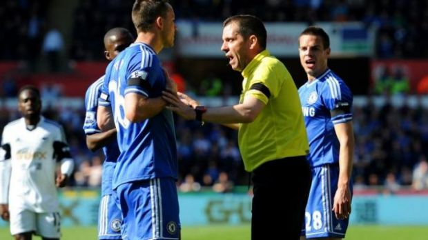 John Terry of Swansea remonstrates with referee Phil Dowd after teammate Andre Schurrle was fouled by Chico Flores.