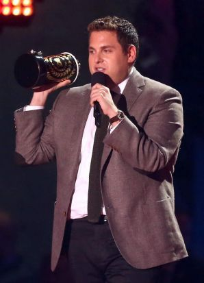 Actor Jonah Hill accepts the best comedic performance award for <i>The Wolf of Wall Street</i> at the 2014 MTV Movie Awards.