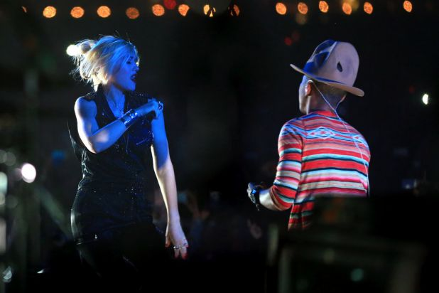 Gwen Stefani, left, was one of several guest appearances during Pharrell's set.