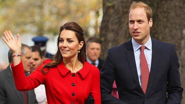 Prince William, Duke of Cambridge and Catherine, Duchess of Cambridge wave to the crowds during the countdown to the ...