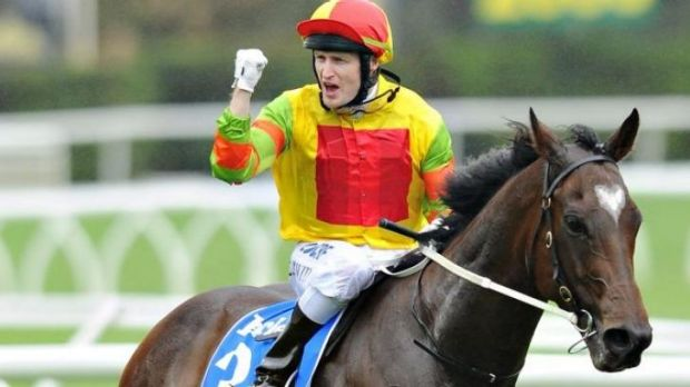 Craig Newitt celebrates after winning the T.J. Smith Stakes on Lankan Rupee on day one of The Championships at Randwick.