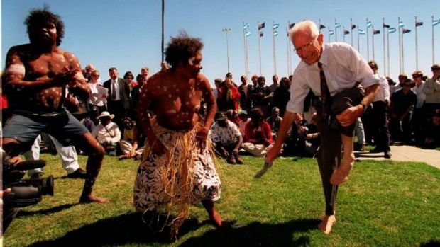 Former independent Tasmanian senator Brian Harradine removes his shoes and socks to dance with members of Cape York's ...