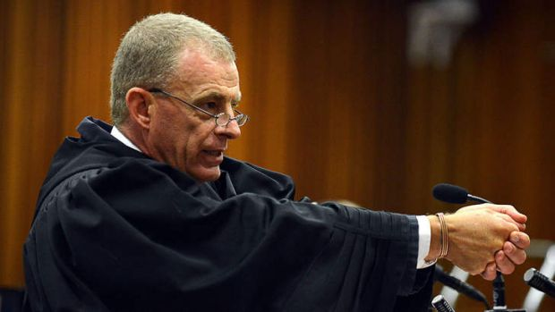 Chief prosecutor Gerrie Nel gestures as he cross examines Oscar Pistorius on Monday.
