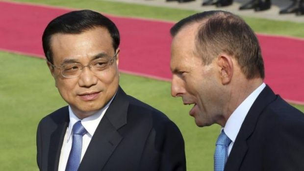 China's Premier Li Keqiang talks to Tony Abbott during the Prime Minister's visit to China.