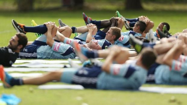 At a stretch: Frank Farina's troops are put through their paces on Tuesday ahead of Friday's elimination final against ...