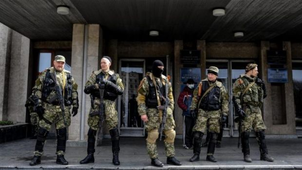 Armed pro-Russian activists stand outside the Ukrainian regional administration building in the eastern Ukrainian town ...