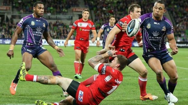 Will Chambers gathers the ball after Josh Dugan (left) of the Dragons fumbled. Chambers went on to score.