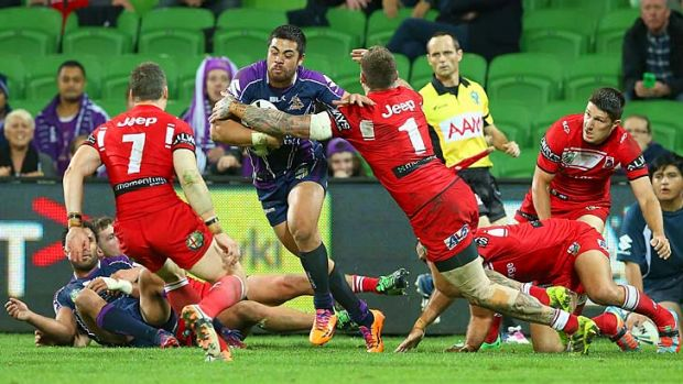 Young Tonumaipea of the Storm breaks through a tackle by Josh Dugan of the Dragons en route to scoring the match-winning ...