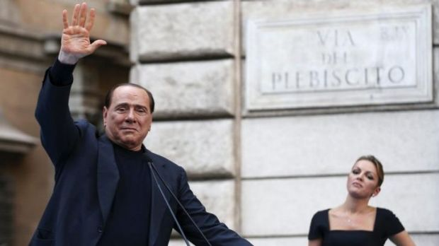Silvio Berlusconi waving to supporters who rallied against his tax fraud conviction last year.