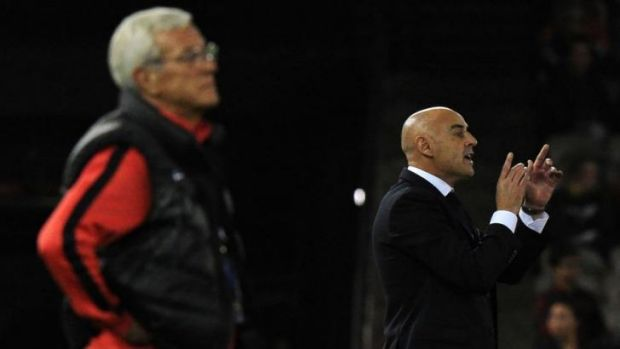 Guangzhou Evergrande coach Marcello Romeo Lippi (left) watches the game as Melbourne Victory coach Kevin Muscat shouts ...