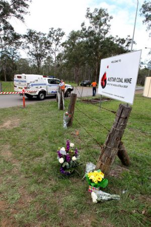 Tragedy: Flowers mark the deaths of two men at the Hunter Valley mine.