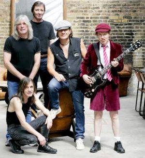 AC/DC's Brian Johnson, centre, says the band plans to record in Vancouver in May. Guitarist Malcolm Young, bottom left, ...