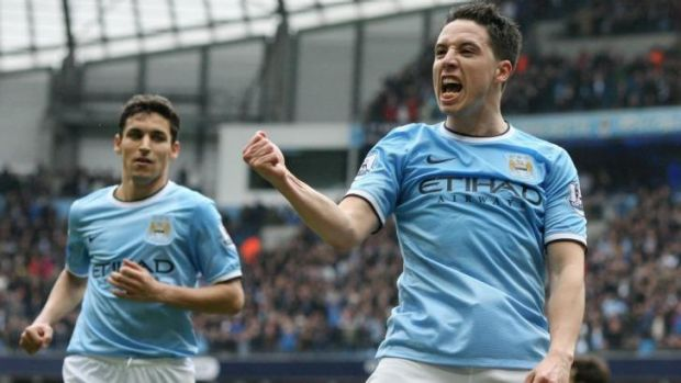 In the money: Manchester City's players are the world's highest paid.